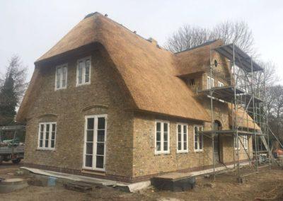 Reetgedecktes Landhaus mit einer Fassade aus DeFries antiken gelben Mauerziegeln Typ Kronprinzenkoog